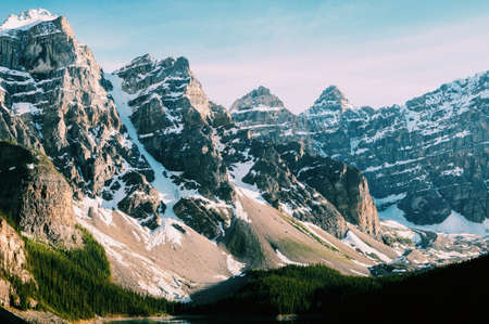 The snow-covered mountain peaks near the Moraine Lake in Canada