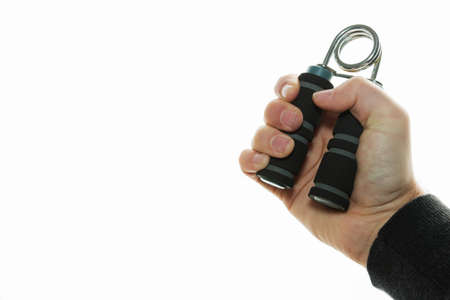 An isolated picture of a person squeezing a handgrip