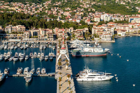A high angle shot of boats near the dock and buildings on the shore in Porto Montenegro, Kotor, Montenegro