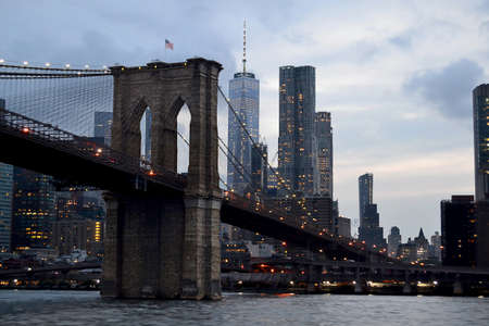 A landscape shot of brooklyn bridge in the new USA with a gray gloomy sky