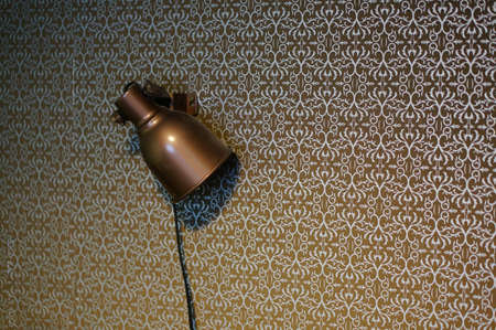 An old vintage lamp attached to a wall Фото со стока