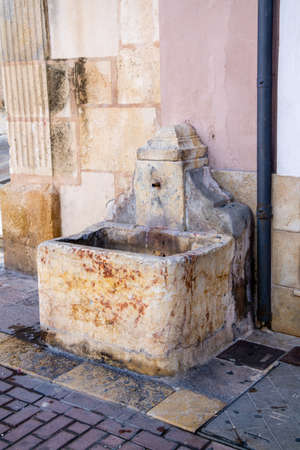 A small fountain in the streets of Xativa, Spain 写真素材