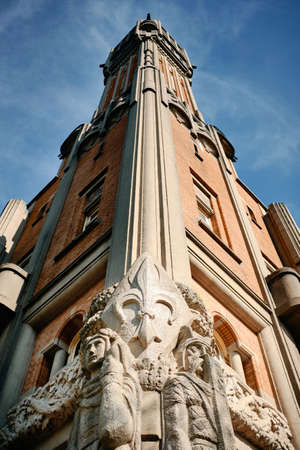 A vertical low angle shot of a building with beautiful sculptures in Lille, France