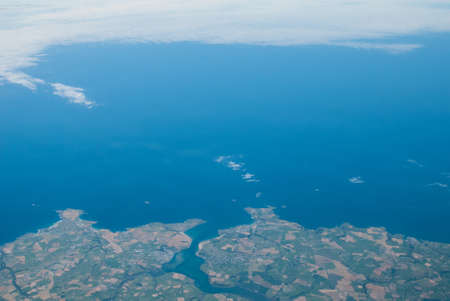 Aerial view of the north Cornwall coastline around Padstow with blue sea and patterned countryside