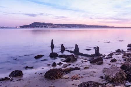 A long exposure shot of the stones on the shore near Portland, Weymouth, Dorset, UK
