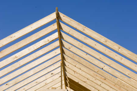 A low angle view of a lumber construction under a blue sky and sunlight at daytime Zdjęcie Seryjne