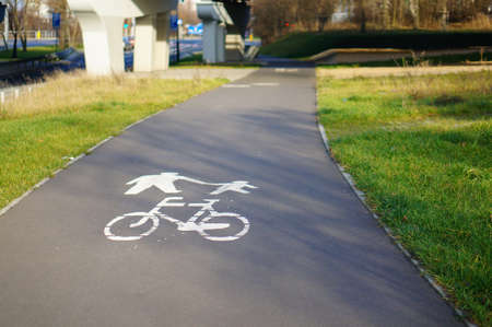 A high angle shot of road signs on the ground for cyclists and pedestrians