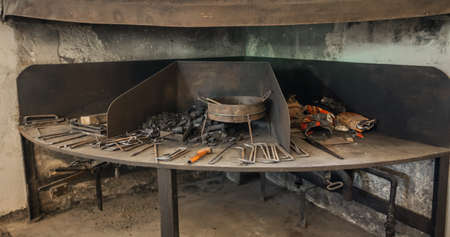 The blacksmith's table inside an old historical blacksmith museum in Slovenia Editoriali