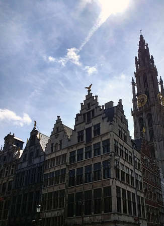 A low angle vertical of the buildings in the Town Square in Antwerp in Belgium