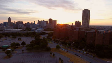 A high angle shot of a cityscape with tall buildings in Buffalo, New York during sunset