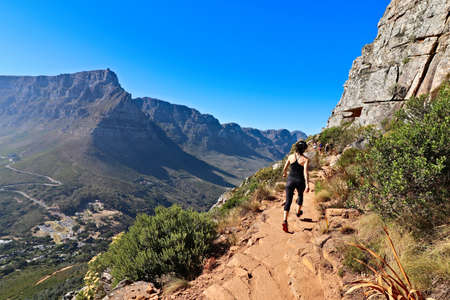 CAPE TOWN, SOUTH AFRICA - Dec 06, 2019: Hikers ascending Lions head mountain. This is a very popular outdoor activity in the city.