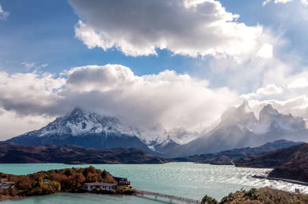 A breathtaking view of the snowy mountains under the cloudy sky in Patagonia, Chile