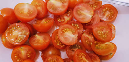 A closeup shot of red tomatoes in the water