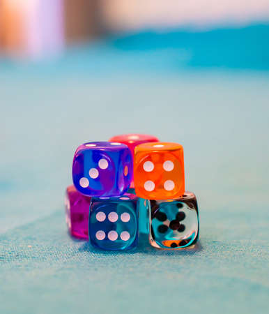 A selective focus shot of several dices on the table