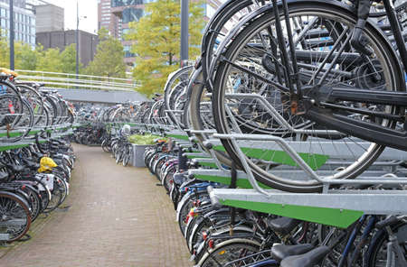 Bicycles parked in city parking in Rotterdam, Netherlands