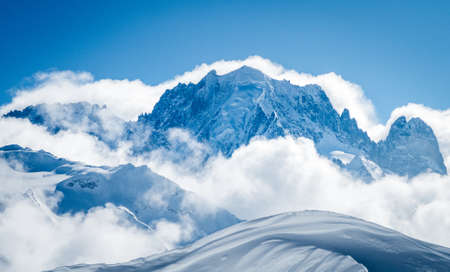 High snowy mountain landscape with blue sky