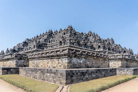 The famous Borobudur Temple in Mungkid, Indonesia with the sky in the background