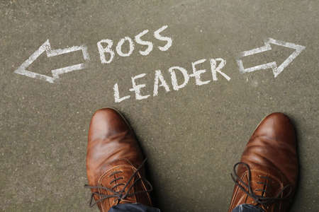 A high angle shot of a person facing the dilemma of becoming either a boss or a leader
