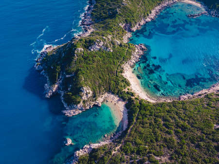 Aerial drone shot of breathtaking shore of Porto Timoni with deep tropical blue and clear turquoise sea, Corfu island, Ionian, Greece 版權商用圖片