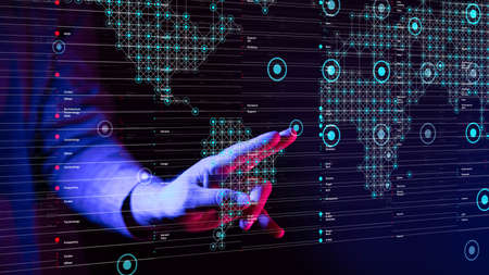 A person working with digital world map data - global network concept