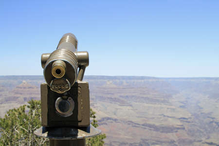 A wide angle shot of a binocular looking at a large open field