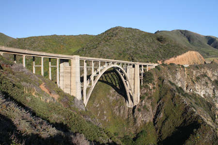 A wide angle shot of the Bixby Creek Arch Bridge in the USA