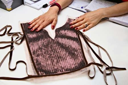 A fashion designer working in her studio workshop.