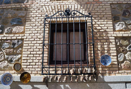 A shot of black window security bars made out of steel in Toledo, Spain