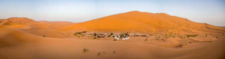 A panorama of the Sahara desert under the sunlight in Morocco in Africa