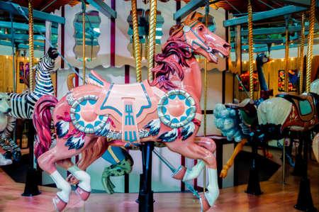 A closeup shot of a multicolored horse on a carousel