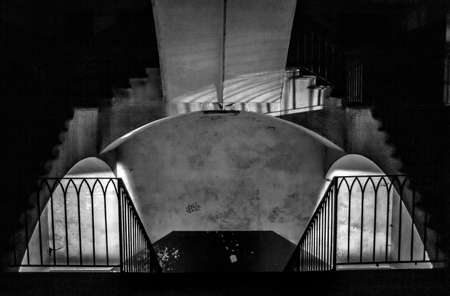 A grayscale shot of an empty staircase