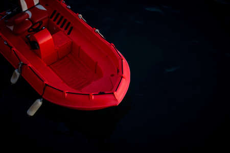 A high angle shot of a cool red boat on the ocean