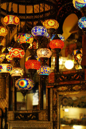 A vertical shot of a ceiling covered in mosaic lamps