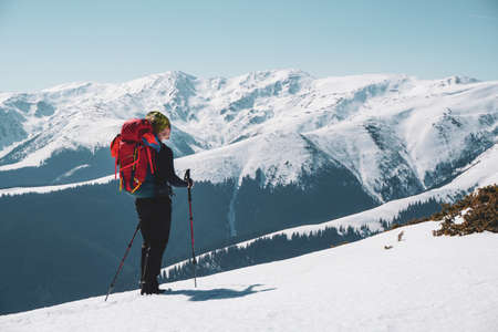 A male mountain climber enjoying  the snow covered mountain view from the summit