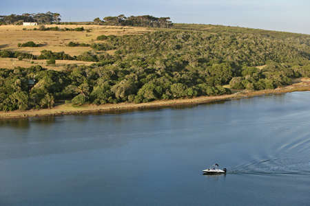ST FRANCIS BAY, SOUTH AFRICA - Dec 15, 2019: A family cruising on a speedboat on the Krom river near St Francis bay. This is a popular vacation area in the Eastern Cape Province of South Africa. Editoriali