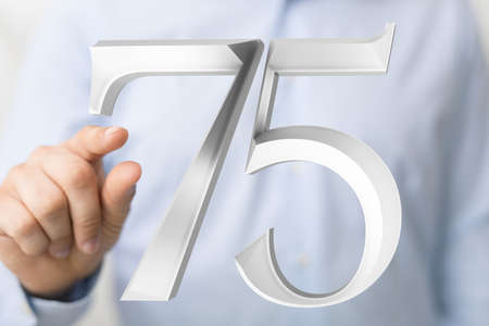 A person presenting a virtual projection of the seventy fifth-anniversary number