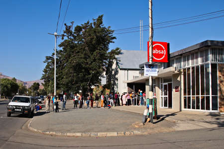 PRINCE ALBERT, SOUTH AFRICA - Aug 12, 2019: People queuing outside an Absa bank on pay day in Prince Albert, South Africa.