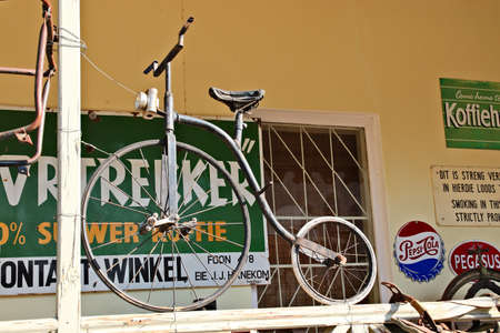PRINCE ALBERT, SOUTH AFRICA - Aug 12, 2019: A Penny Farthing vintage bicycle on display at the The Olde Shop antique store in Prince Albert, South Africa.