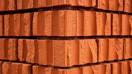 A closeup shot of red bricks at the corner of a building