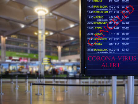 A great shot of an image display board displaying canceled flights in an airport
