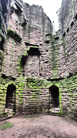 A vertical shot of a wall of the ruins of Goodrich Castle in Herefordshire, England