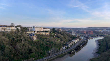 The mesmerizing view of the Bristol city in the United Kingdom on the bank of a river during daytime Banco de Imagens