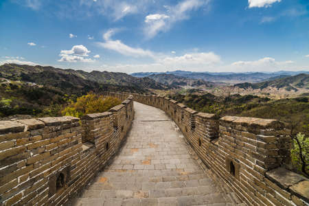 A beautiful shot of the great wall of china with mountains in the distance