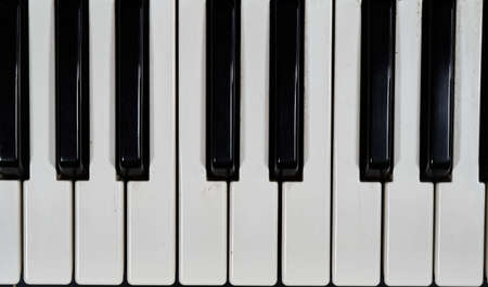 The black and white tiles of a piano during daytime