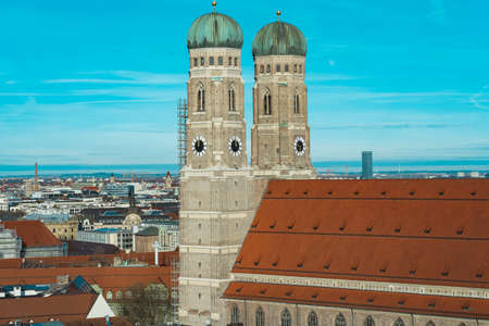The Frauenkirche surrounded by buildings under the sunlight and a blue sky in Germany