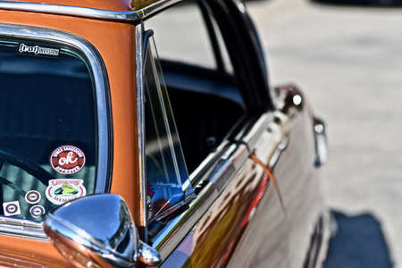 DOWNERS GROVE, UNITED STATES - Jun 07, 2019: A closeup shot of a shiny vintage car with a blurred background