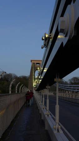 A vertical shot of Brunel suspension bridge in Bristol, the United Kingdom in the evening