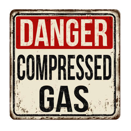 A vintage caution sign of Danger Compressed Gas on a white background