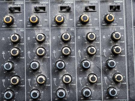 A closeup shot of knobs on the mixer Stock Photo