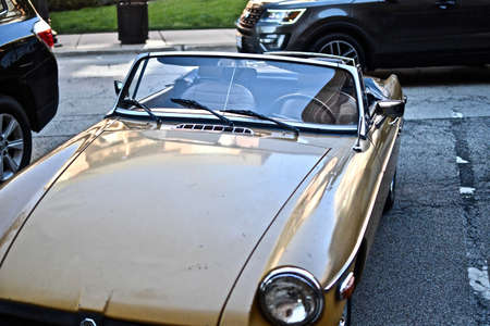 DOWNERS GROVE, UNITED STATES - Jun 07, 2019: A high angle shot of a vintage car parked in a parking lot